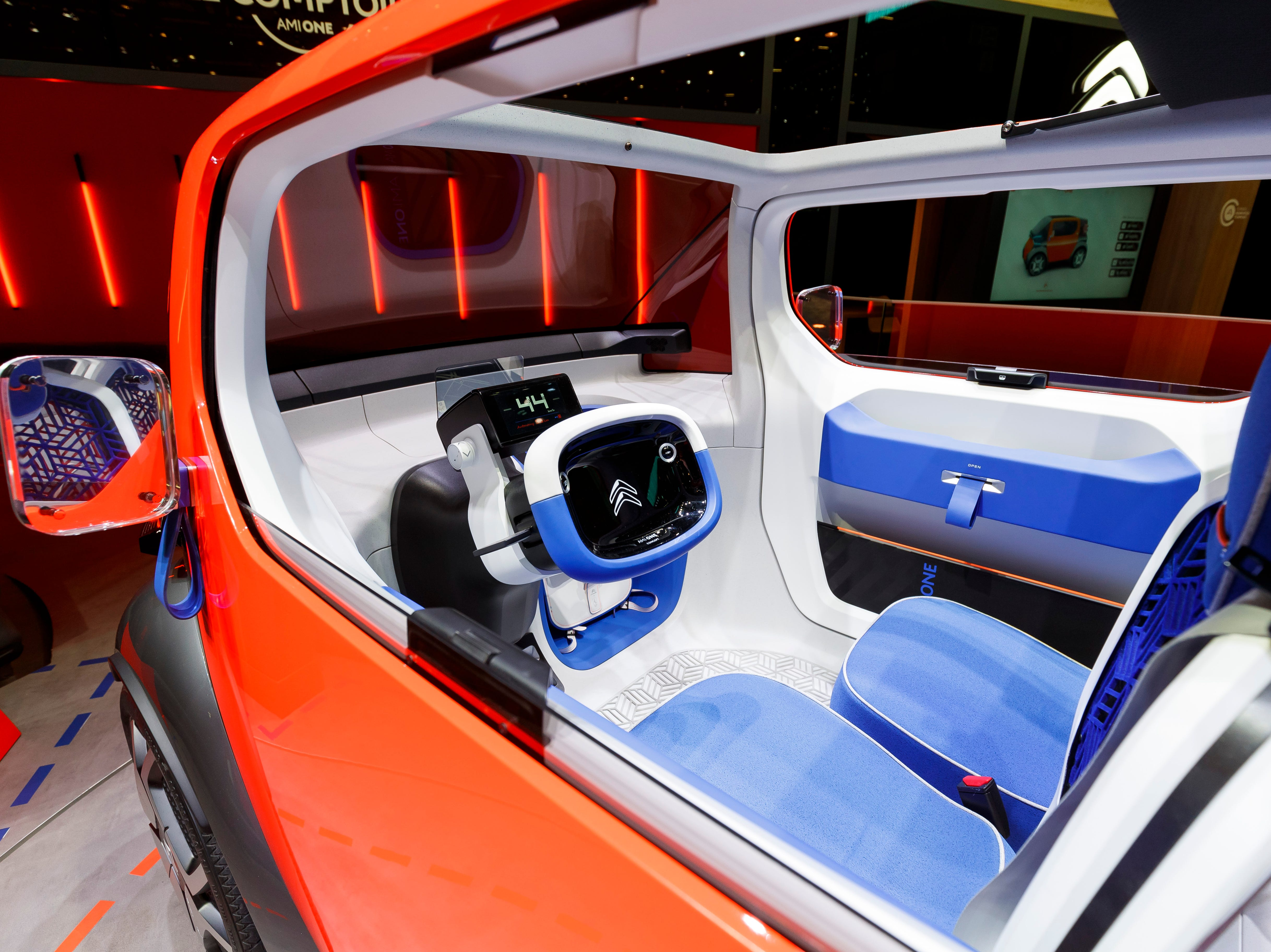 The Citroen Ami One Concept car is shown, one of many electric car concepts.