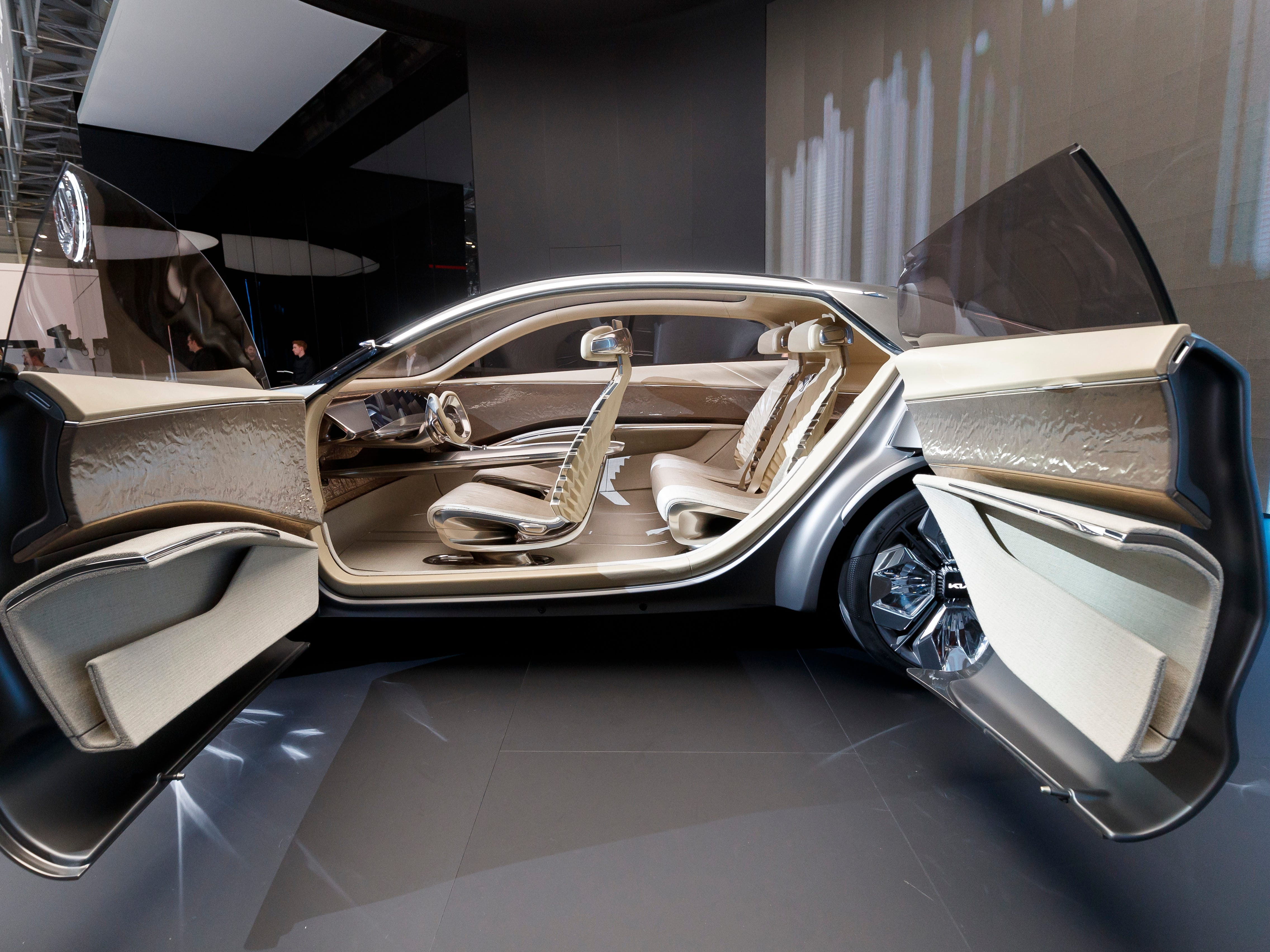 """The doors of the new Kia """"Imagin"""" concept car are opened during the press day at the 89th Geneva International Motor Show."""