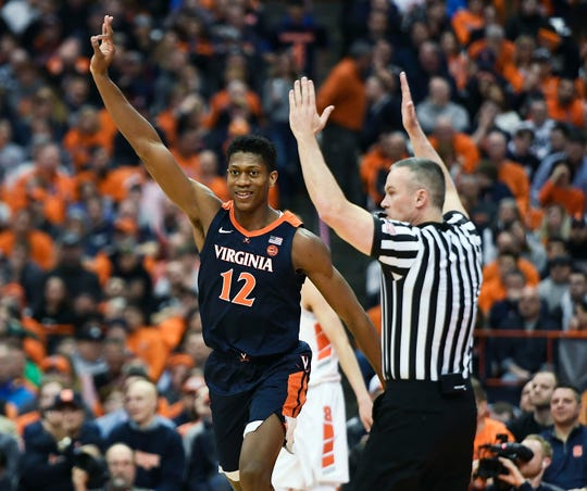 Virginia guard De'Andre Hunter celebrates a 3-pointer during the second half Monday. No. 2 Virginia defeated Syracuse 79-53.