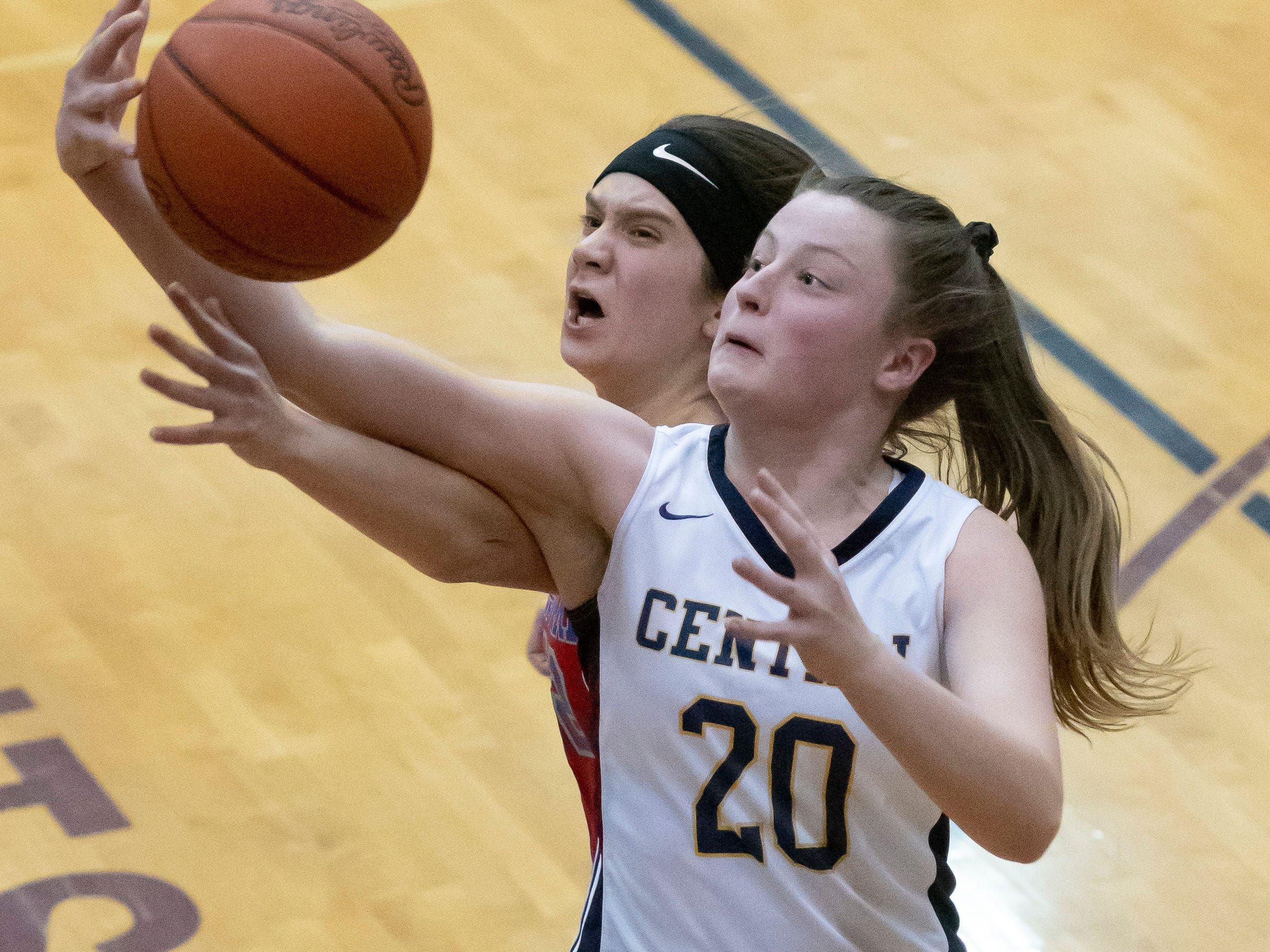 Walled Lake Western forward Lia Krawiec, left, and Walled Lake Central's Isabelle Plautz battle for a rebound in the second half.