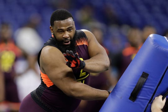 Former Alabama defensive lineman Isaiah Buggs runs a drill during the NFL combine Sunday in Indianapolis.