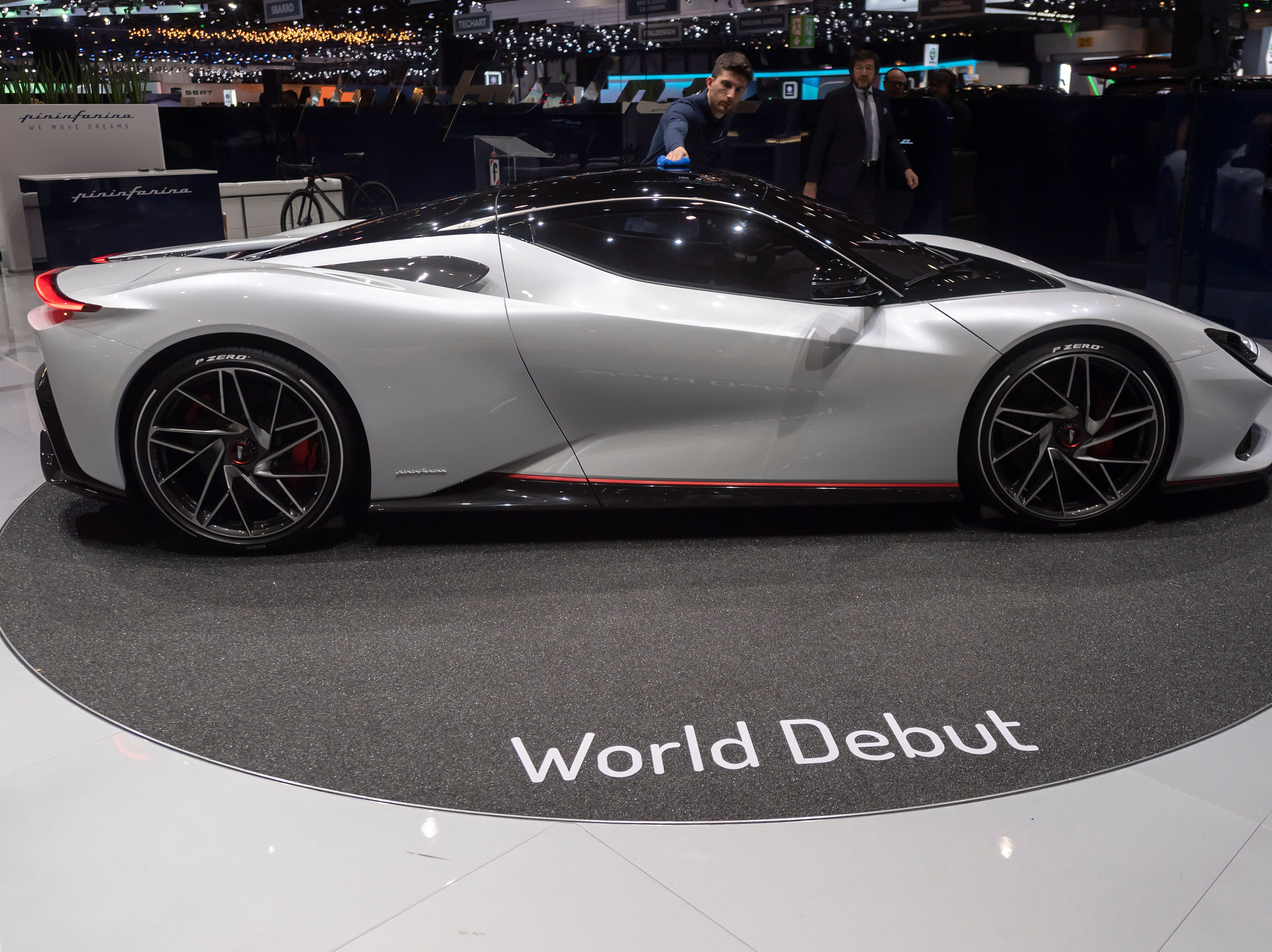 The Pininfarina Battista is polished at the Geneva International Motor Show in Geneva, Switzerland.