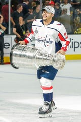 Madison Bowey, now a defenseman for the Red Wings,  skates with the Stanley Cup after the Washington Capitals' Cup-clinching victory over the Vegas Golden Knights.