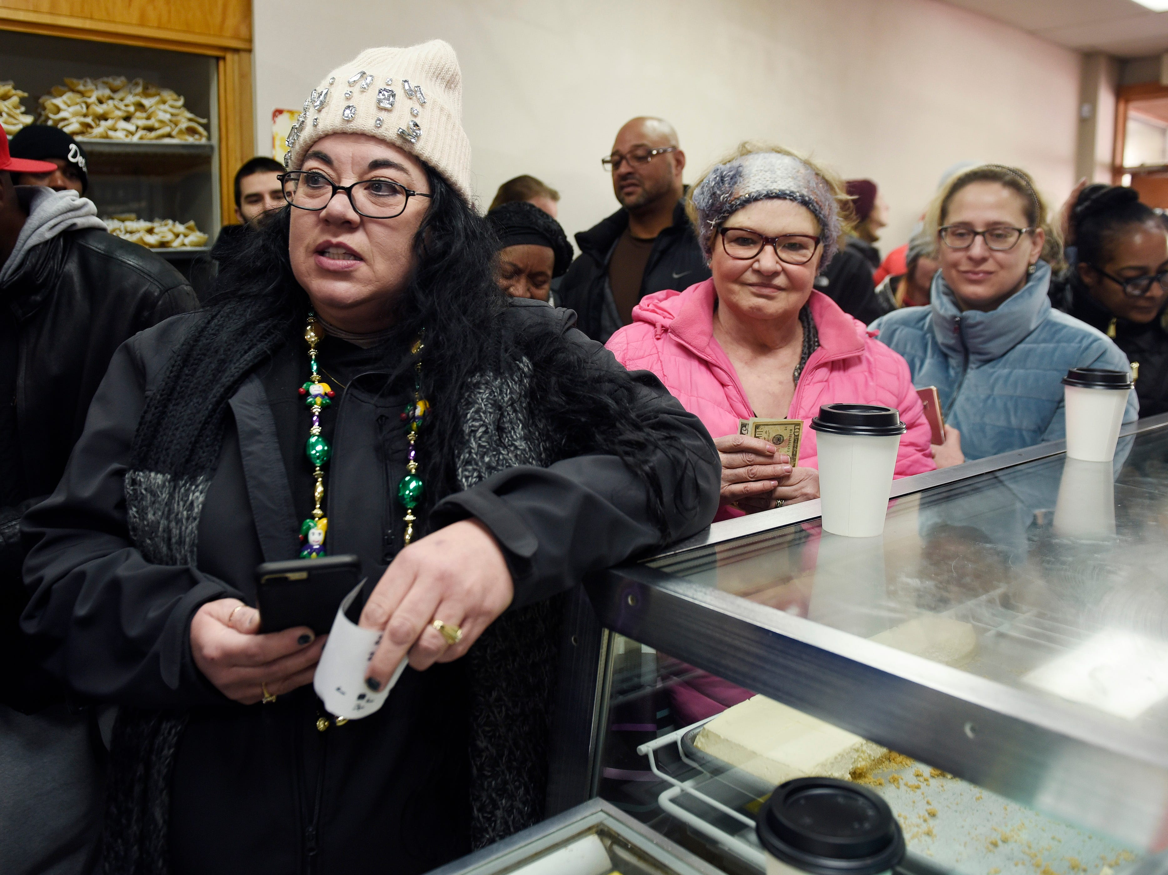 Koleen Schaf, (l), of Tayor and Caroline Stokes, (r), of West Bloomfield wait in line to purchase their paczki at New Martha Washington Bakery.