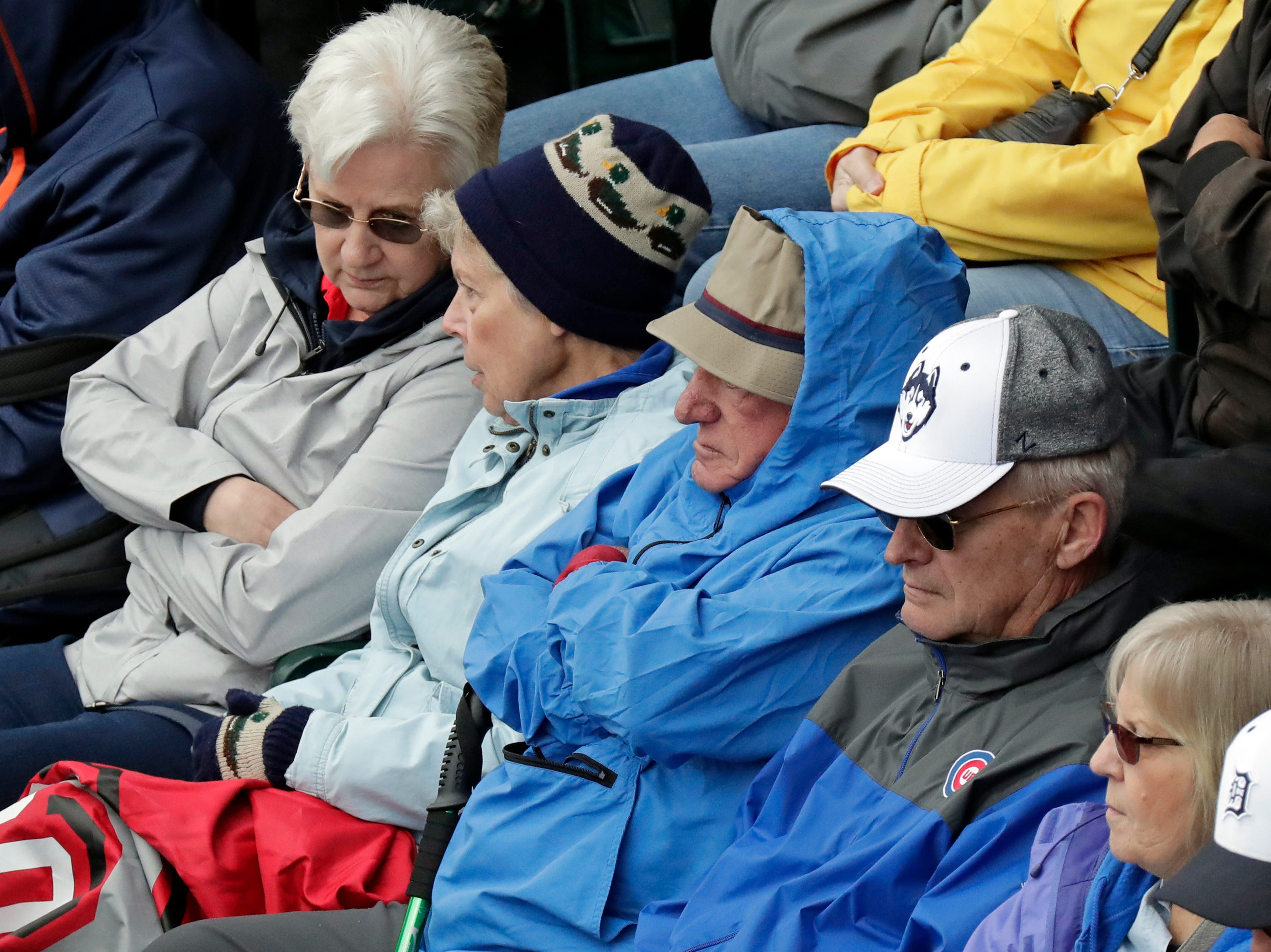 Fans bundle up as they watch a spring baseball exhibition game between the Detroit Tigers and the Toronto Blue Jays, Tuesday, March 5, 2019, in Lakeland, Fla. Temperatures were in the upper 50's during the game.