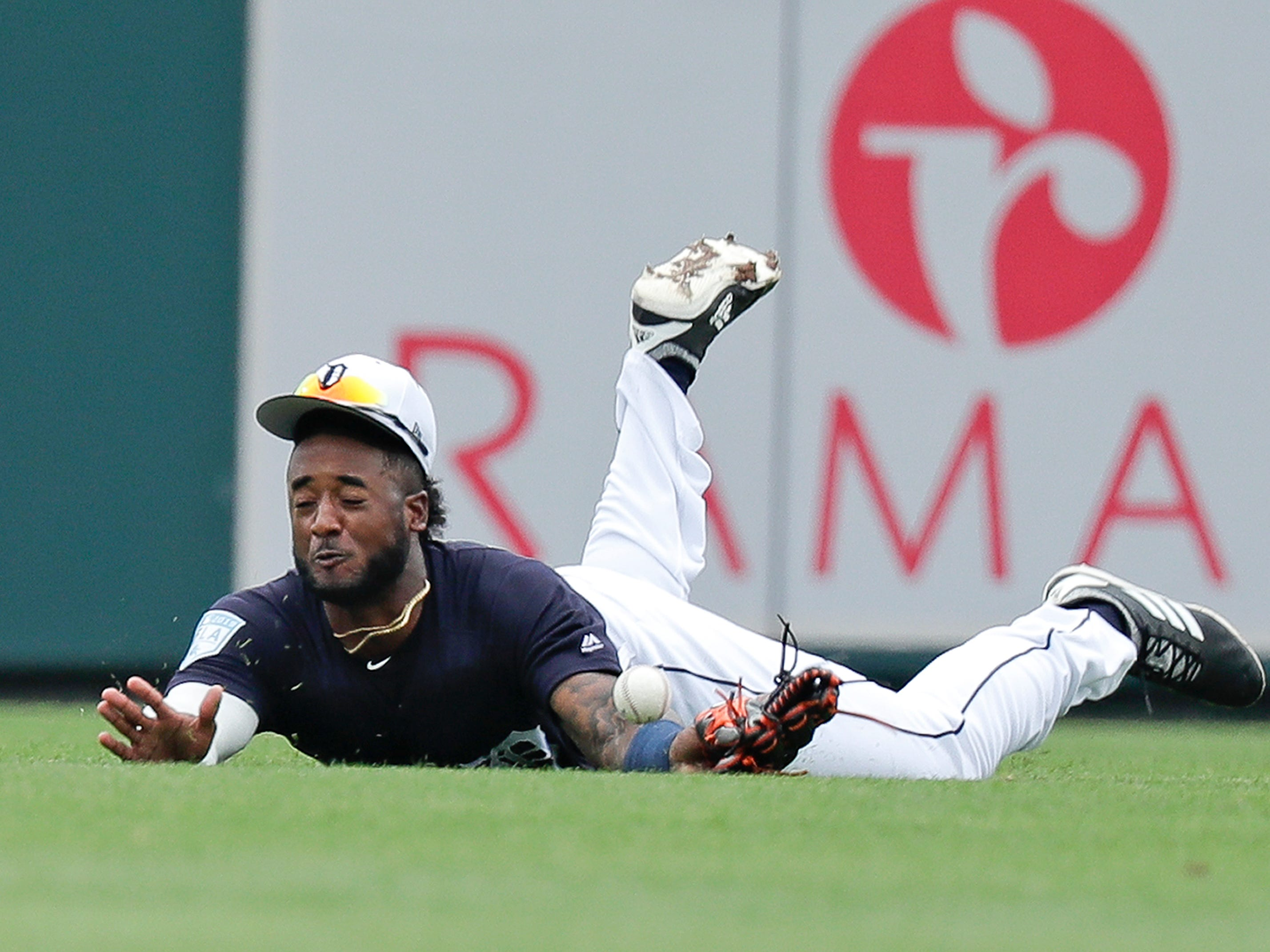 Detroit Tigers center fielder Niko Goodrum dives but can't make a catch on a base hit by Toronto Blue Jays Danny Jansen in the second inning of a spring baseball exhibition game, Tuesday, March 5, 2019, in Lakeland, Fla.