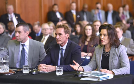 Gov. Gretchen Whitmer, right, presents her budget proposal to lawmakers during a joint meeting of the House and Senate appropriations committees in the Senate Hearing Room on the ground floor of the Boji Tower in Lansing on Tuesday.