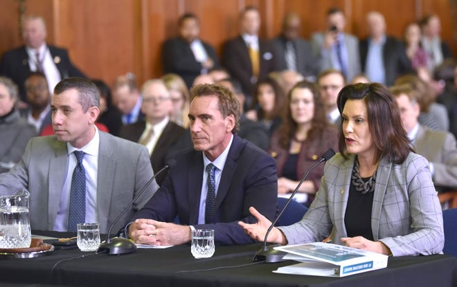 Michigan Gov. Gretchen Whitmer (right) presents her 'fiscal year 20 budget proposal,' called, 'The Road To Opportunity,' to lawmakers during a joint meeting of the House and Senate appropriations committees in the Senate Hearing Room on the ground floor of the Boji Tower in Lansing, Tuesday morning, March 5, 2019. With her are Deputy State Budget Director Kyle Jen (left) and and Budget Director Chris Kolb (center).