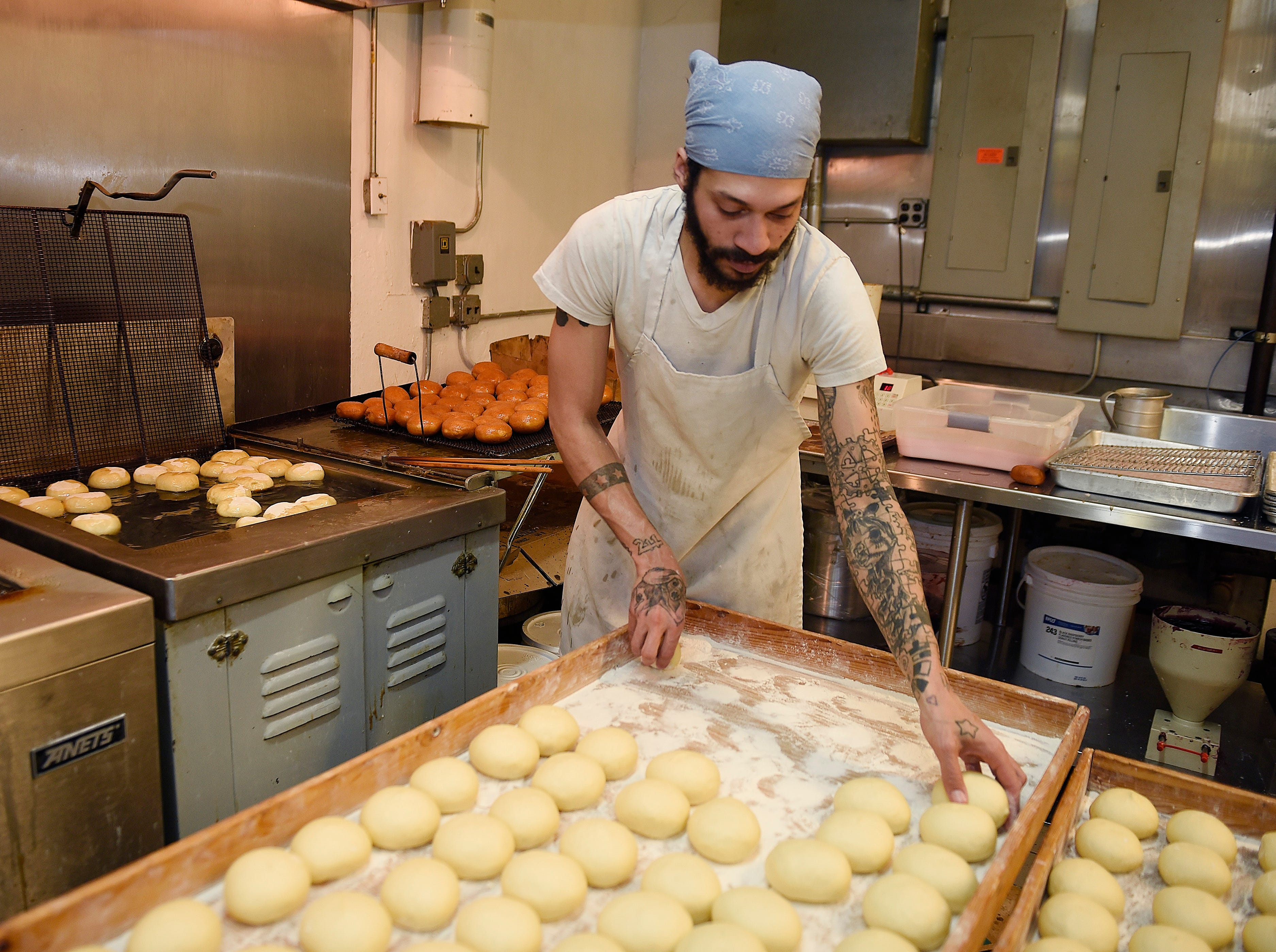 Phil Warren, 33, prepares to fry a batch of paczki.