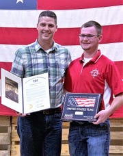 State Rep. Clint Owlett, left, presents Colton Pierce of Troy with a House citation recognizing Pierce for his achievement of capturing top individual honors in the 2018 Youth Hunter Education Challenge national championship.
