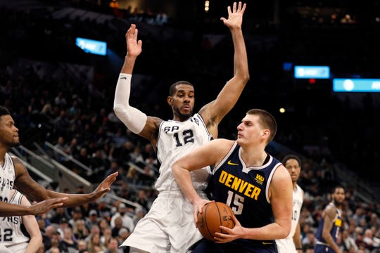 Nikola Jokic, shown working against San Antonio's LaMarcus Aldridge during a game Monday, and the Denver Nuggets will play a road game at 8:30 p.m. Wednesday night against the Los Angeles Lakers.