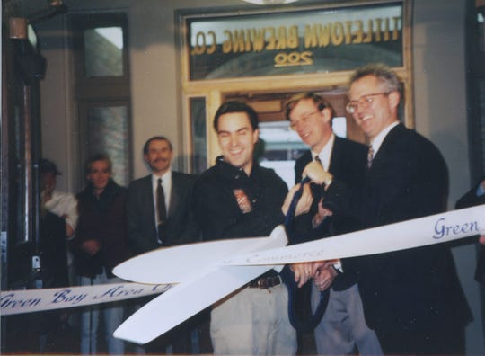 From left, Brent Weycker, John Hickenlooper and John Gustavson cut the ribbon at the Titletown Brewing Co. opening in 1996. Hickenlooper was a co-founder of the Green Bay brewery.