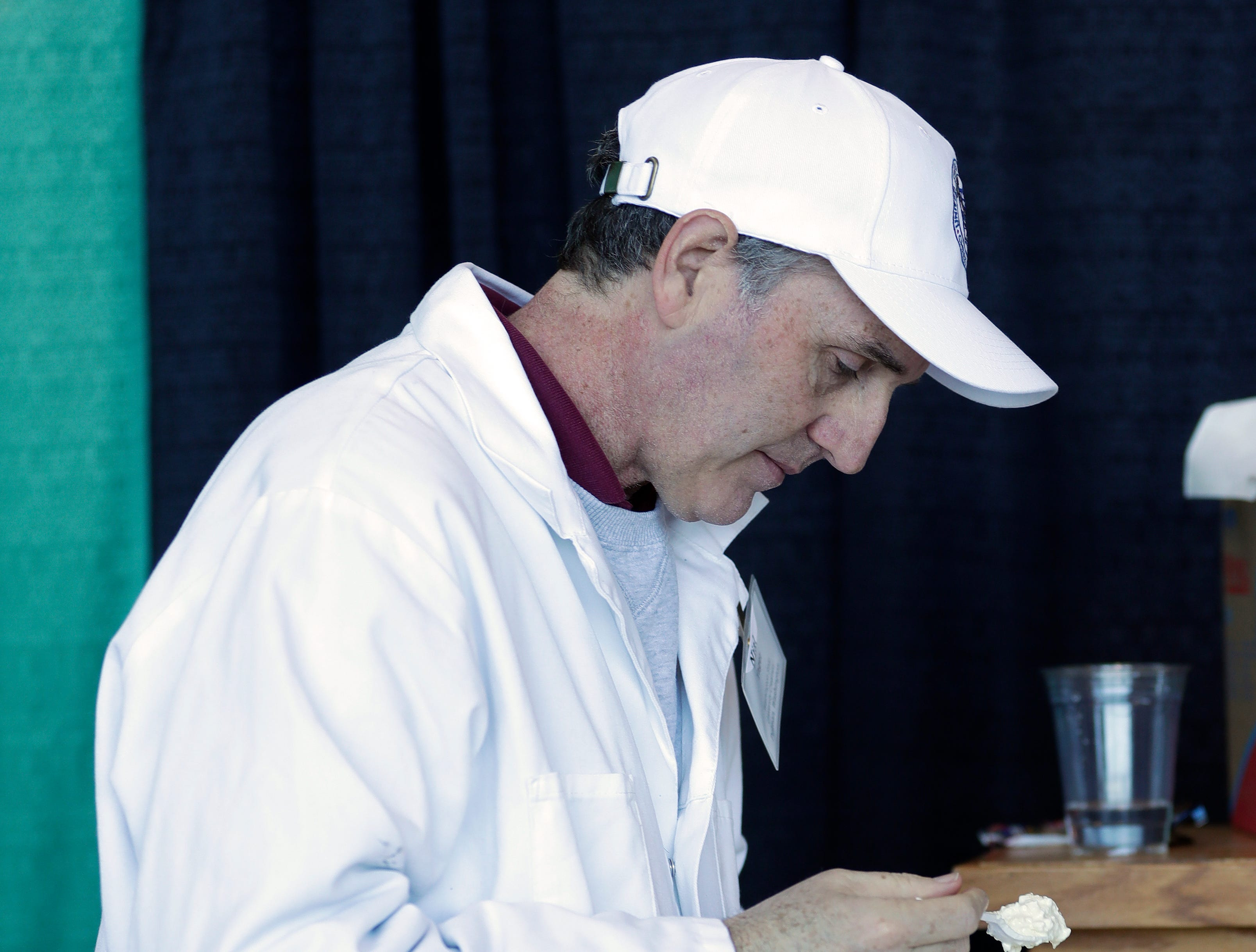 Nial Yager of Washington State University judges cottage cheese during the U.S. Championship Cheese Contest on March 5, 2019 at Lambeau Field in Green Bay, Wis. Sarah Kloepping/USA TODAY NETWORK-Wisconsin