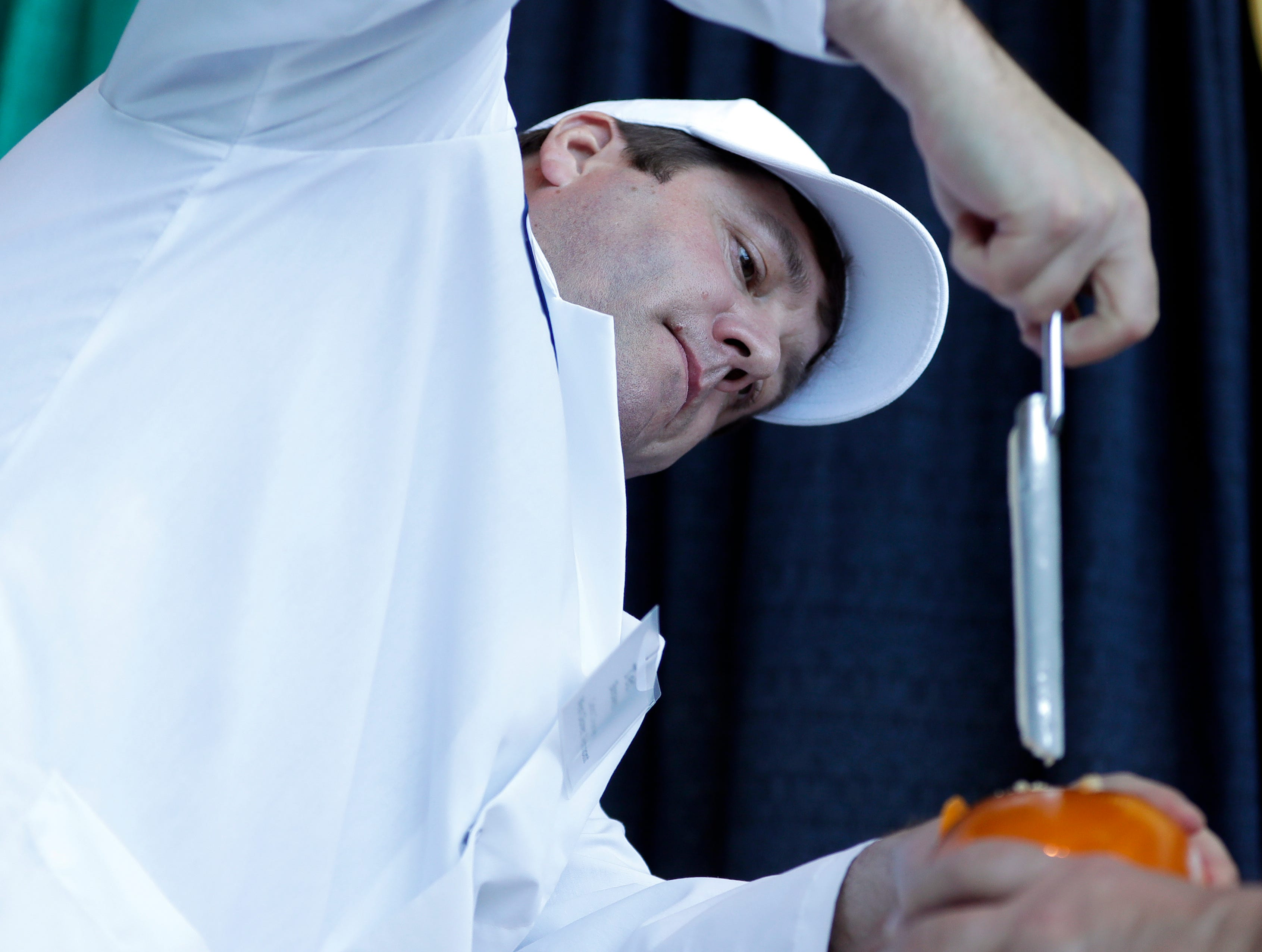 Ted Brown of Cabot Creamery in Vermont, pulls a sample from a smoked gouda during the U.S. Championship Cheese Contest on March 5, 2019 at Lambeau Field in Green Bay, Wis. Sarah Kloepping/USA TODAY NETWORK-Wisconsin