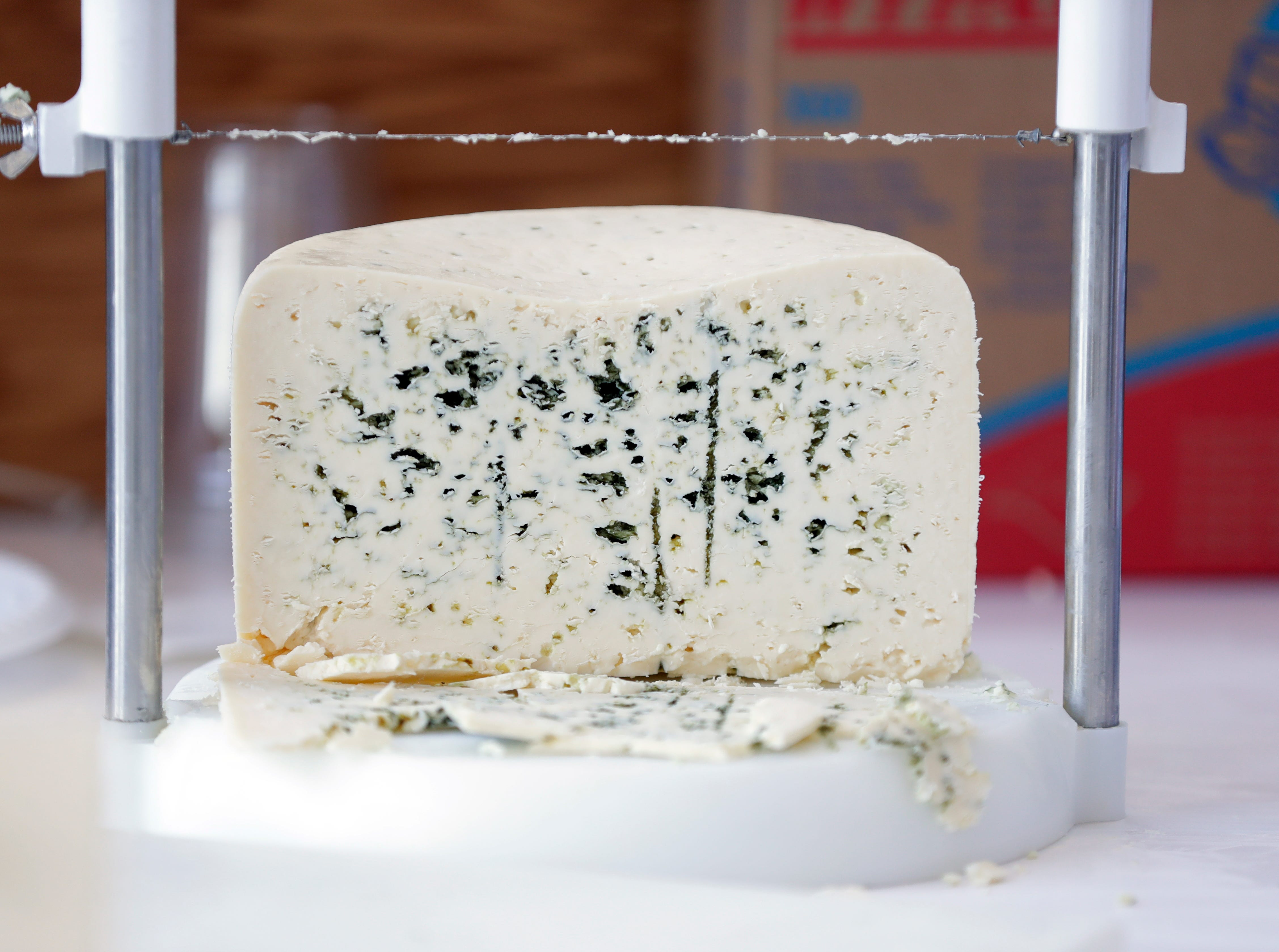 A blue-veined cheese is judged March 5, 2019, during the U.S. Championship Cheese Contest at Lambeau Field in Green Bay, Wis. Sarah Kloepping/USA TODAY NETWORK-Wisconsin