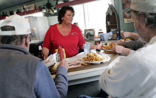 Lea Zimanek of River Street Pier serves up plates of smelt to lunch customers. It shows up on the Howard bar's menu after the first of the year and is available on Wednesdays into May.
