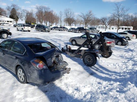 Cars involved in a crash Tuesday on the Leo Frigo Memorial Bridge were taken to a parking lot at Bay Beach.