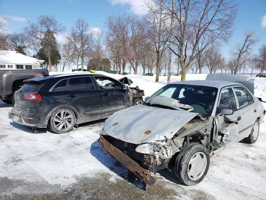 Cars involved in a crash Tuesday on the Leo Frigo Memorial Bridge were taken to a parking lot at Bay Beach Amusement Park.