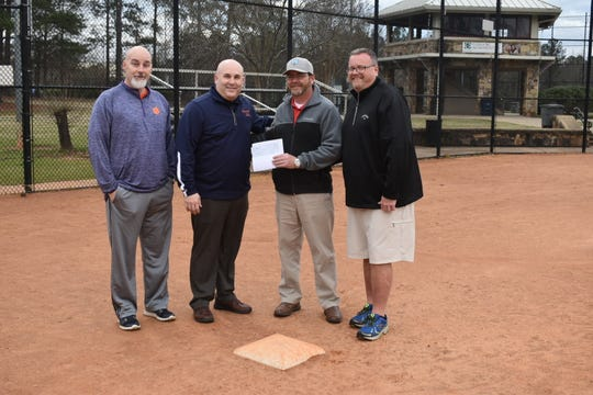 Shaun Blake, CEO of the MB6 Foundation presents a check for $500 to Simpsonville Athletics Director Chad Foster