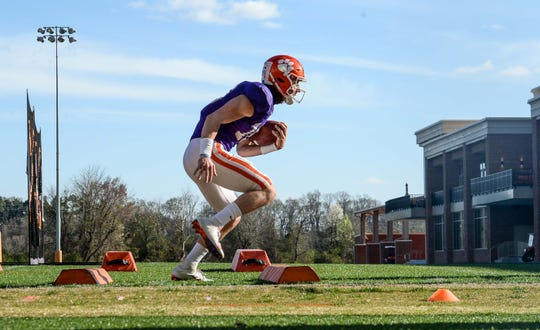 Clemson quarterback Trevor Lawrence (16) runs in a drill during practice outside the Poe Indoor Facility in Clemson Monday.