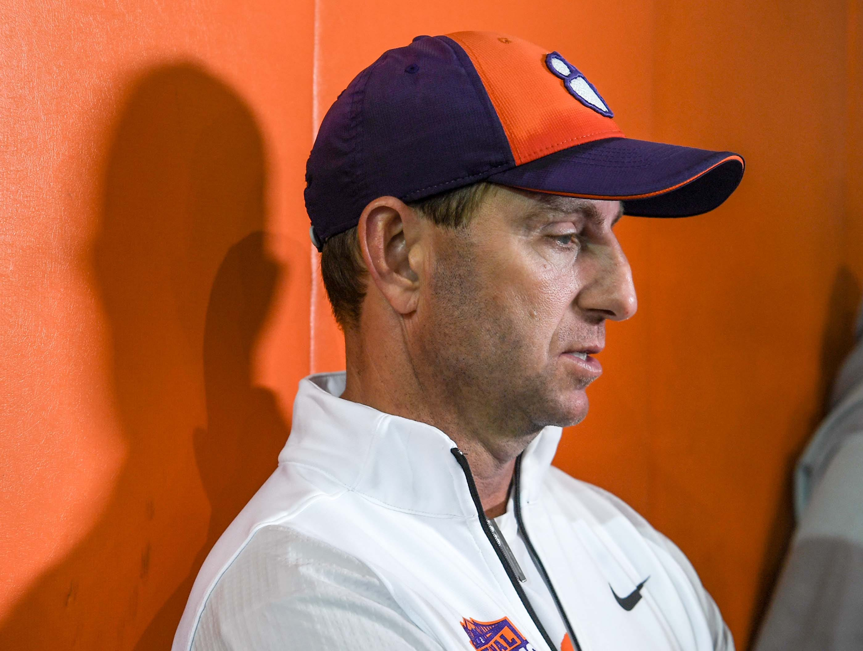 Clemson Head Coach Dabo Swinney speaks with media after practice at the Poe Indoor Facility in Clemson Monday.