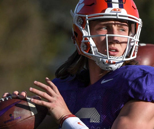 Clemson quarterback Trevor Lawrence (16) throws during practice at the Poe Indoor Facility in Clemson Monday.