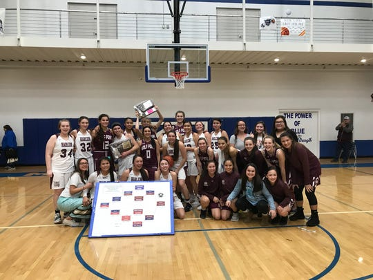Girls' basketball teams from Harlem and Wolf Point posed for a photo after the Northern B divisional tournament two weeks ago in Malta. Both teams will be competing at the State B combined tourney this weekend in Belgrade.