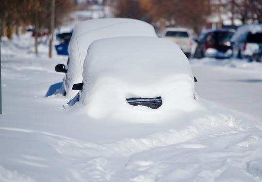 Some cars remain buried in snow after the month of February which saw over 30 inches of snow in Great Falls.