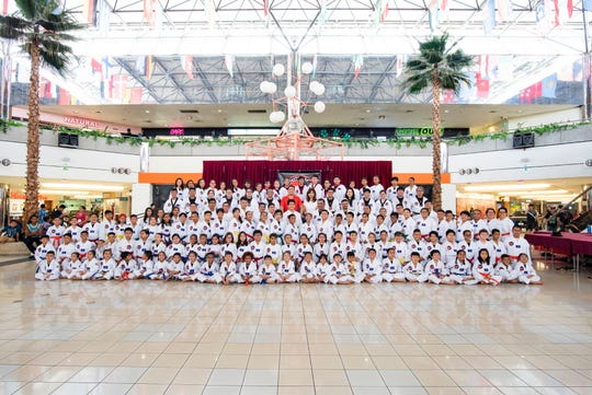 One hundred forty seven students from Guam Taekwondo Center, Inc. attended the opening ceremonies of the 8th Master Noly's Taekwondo Poomsae Tournament held at the Micronesia Mall on March 2. Patrick Luces of Guam Public Health and the Guam Diabetes Association was the keynote speaker and addressed the importance of exercise and health, while Rogel Edusma delivered the oath of sportsmanship. Judges for the forms competition were Judge Maria Cenzon, Eduardo Tuason and Marc Moises.  About 117 athletes competed in the regular poomsae, while an addition 32 competitors in the freestyle event.  Outstanding performances were made by double gold medalists, Ryan Gaza and Christian Caballero. Students lined up during the opening ceremonies for a photo op with Master Noly Caluag, founder and chief instructor of Guam Taekwondo Center, Inc., center and his wife, Malu Caluag, office manager.