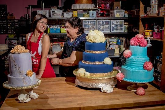 Laling Pangelinan, who has run her cake business from home since 1985, is now teaching her granddaughter Dora Cruz the art of baking and decorating cakes.