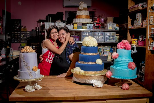 Laling Pangelinan, owner of Laling's Cakes, shares a hug with her granddaughter Dora Cruz in Pangelinan's home bakery in Maite on Feb. 21.