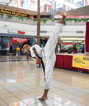 Double gold medalist Ryan Gaza executes the high side kick as part of the Koryo during the 2019 Master Noly's Taekwondo Poomsae Tournament at the Micronesia Mall.
