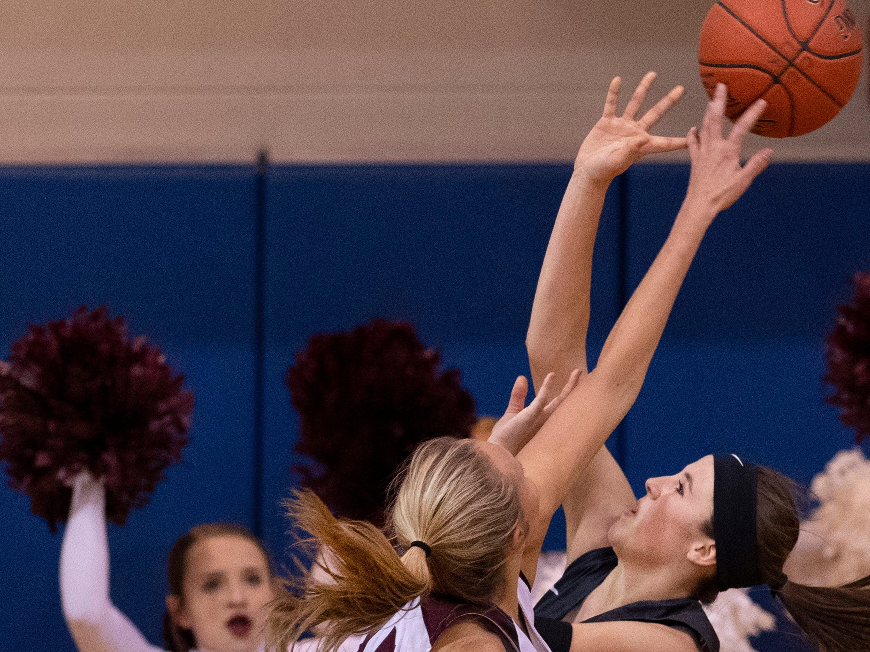 Henderson County's Alyssa Dickson (15) blocks the shot of Madisonville's Cortney Peyton (33) during the Girls Region Tournament semifinals at the Rocket Arena in Marion, Ky., Monday night.