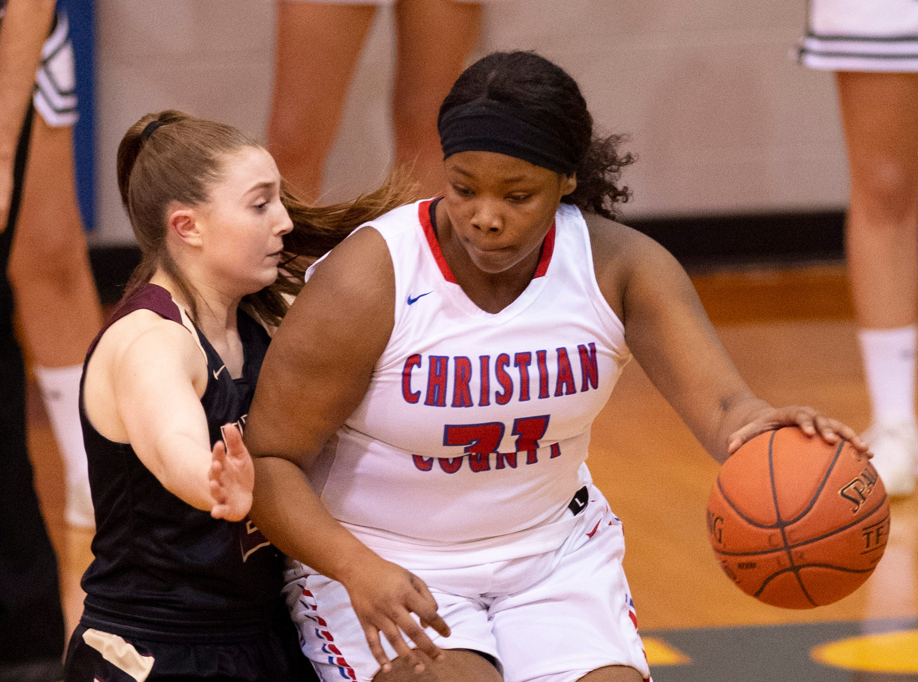 Webster County's Mariah Austin (21) defends Christian's Trinity McGee (31) during the Girls Region Tournament semifinals at the Rocket Arena in Marion, Ky., Monday night.