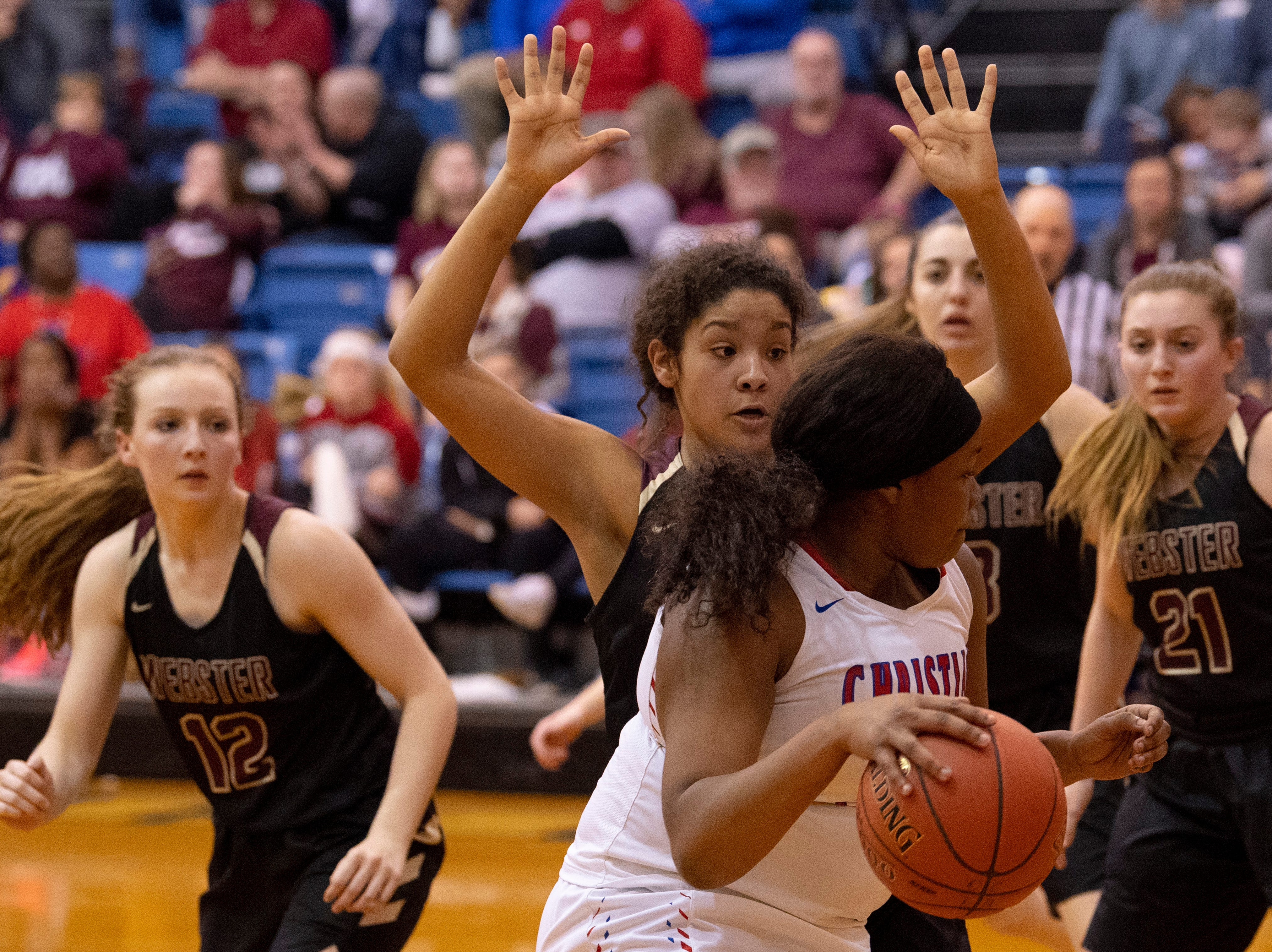 Christian's Trinity McGee (31) is guarded by Webster County's Raigan Price (31) during the Girls Region Tournament semifinals at the Rocket Arena in Marion, Ky., Monday night.