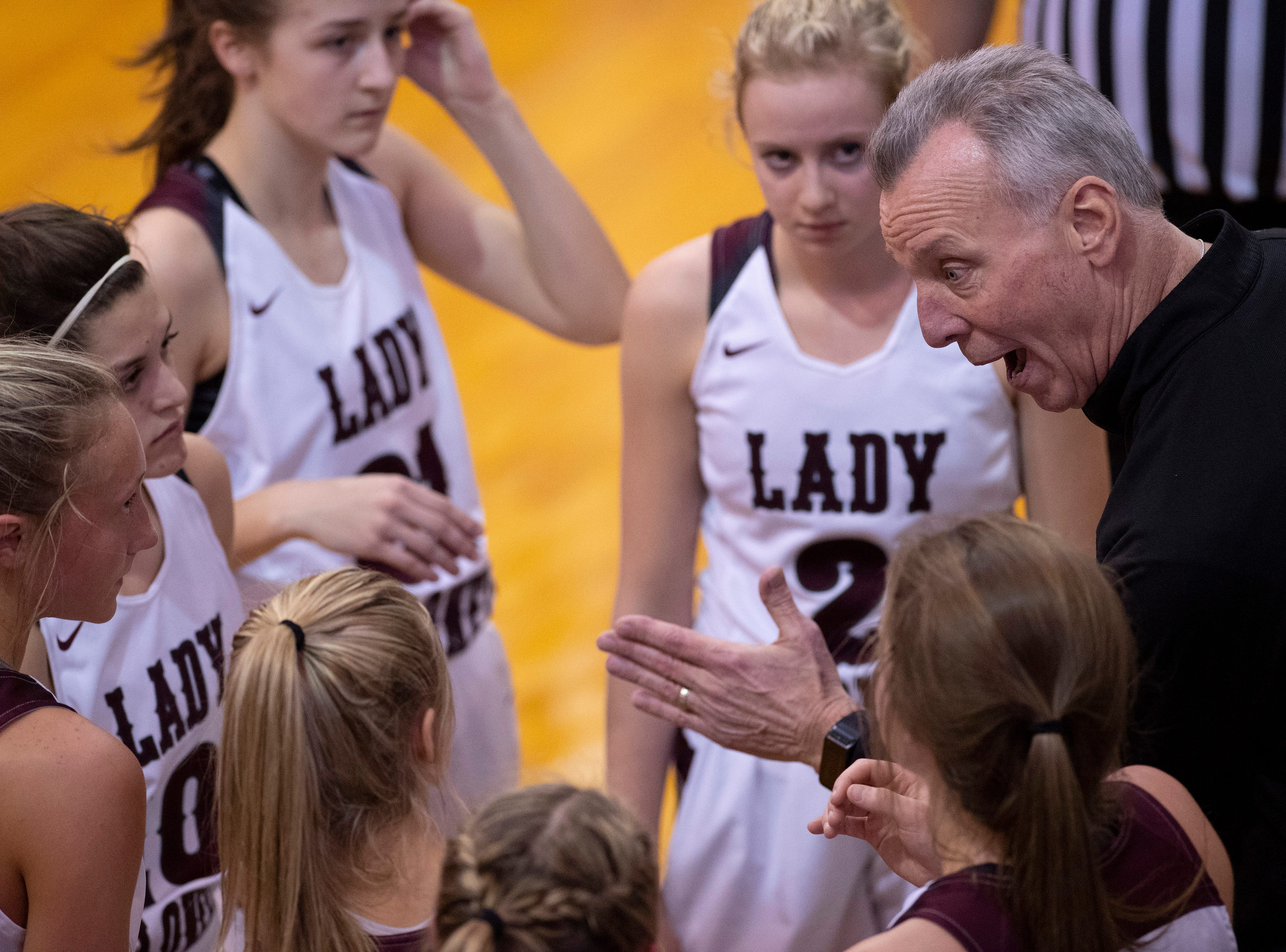 Henderson County Head Coach Jeff Haile offers instructions to his team as they take a timeout against Madisonville during the Girls Region Tournament semifinals at the Rocket Arena in Marion, Ky., Monday night.