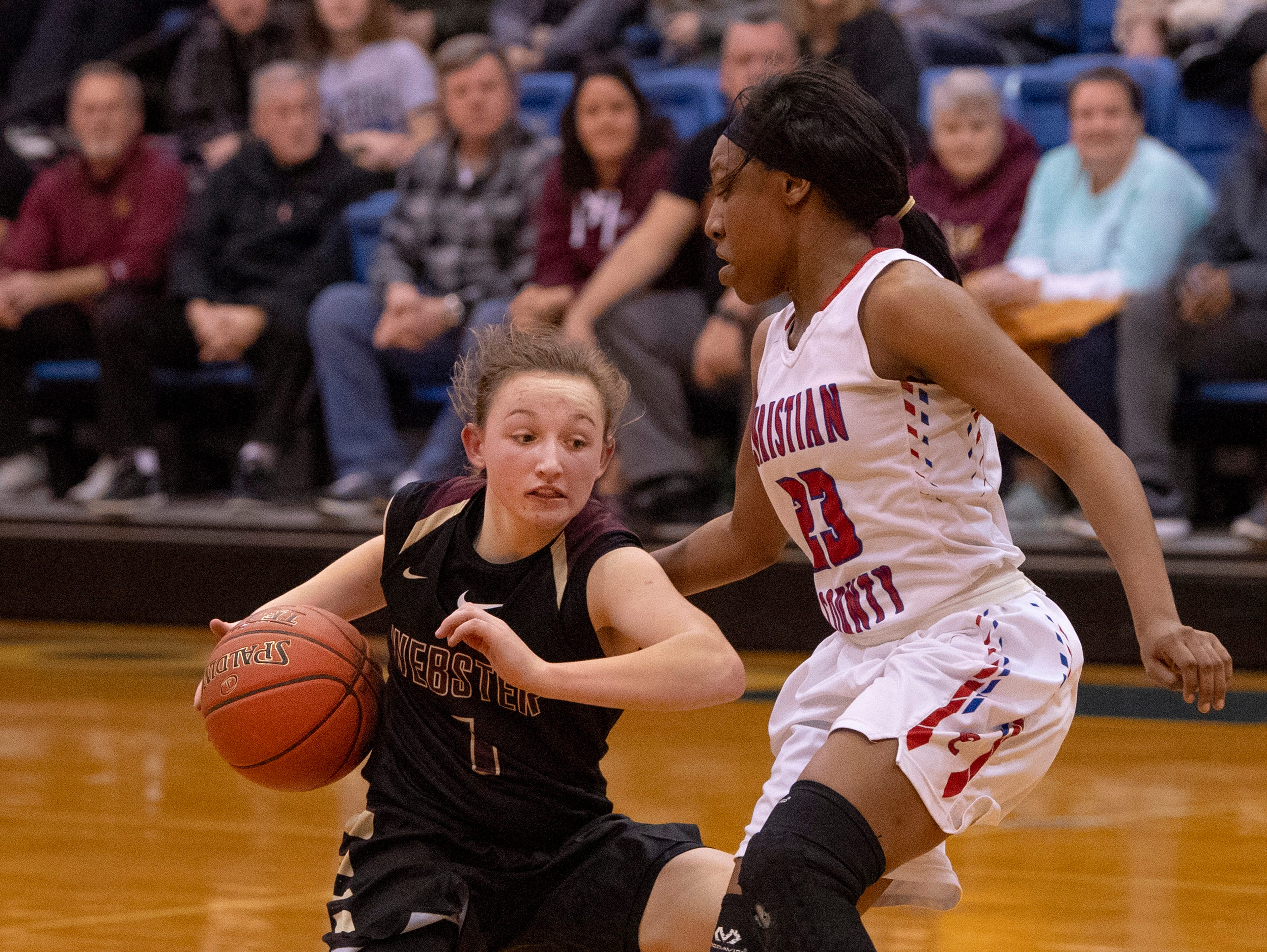 Webster County's Sadie Wurth (1) is defended by Christian's Aaliyah Hampton (23) during the Girls Region Tournament semifinals at the Rocket Arena in Marion, Ky., Monday night.