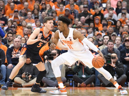 Mar 4, 2019; Syracuse, NY, USA; Syracuse Orange forward Oshae Brissett (11) controls the ball as Virginia Cavaliers guard Kyle Guy (5) defends in the first half at the Carrier Dome.