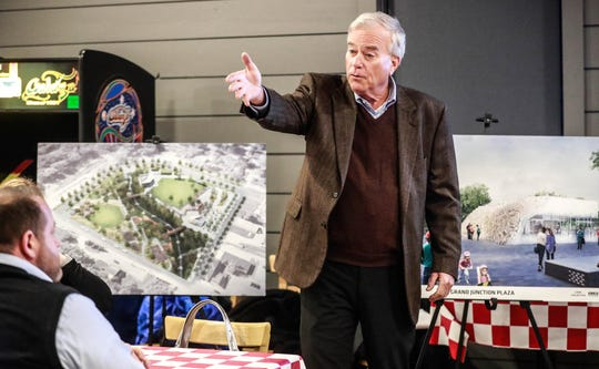Mayor Andy Cook outlines the thirty five million dollar Grand Junction Plaza during a information meeting held at Greeks Pizzeria in Westfield, on Monday, March 4, 2019. Concerned citizens and supporters of the project were in attendance to ask questions and discuss the proposed plan.