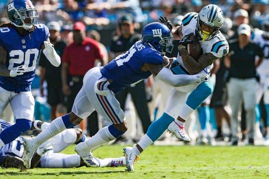 Oct 7, 2018; Charlotte, NC, USA; New York Giants defensive back Landon Collins (21) controls the ball as Carolina Panthers wide receiver DJ Moore (12) tackles during the second half at Bank of America Stadium.