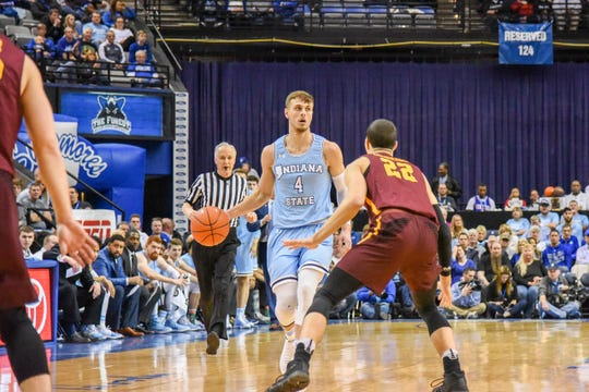 Cooper Neese on the move against Loyola (Chicago). Neese has recently gotten his mojo back.
