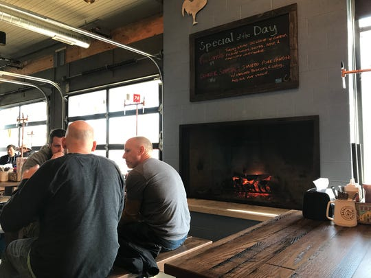 A grand fireplace flanks the dining room between garage doors that open in spring to a patio area that seats another 200 guests at Half Liter BBQ, 5301 Winthrop Ave., Indianapolis. The restaurant opened March 4, 2019 south of Broad Ripple.