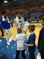 Former Cloverdale star Cooper Neese greets young fans.