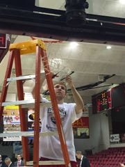 Jonny Marlin cutting down the net after Indiana Wesleyan's Division II title win.