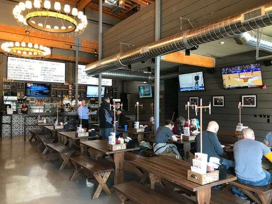 A bar overlooks the family-friendly dining room at Half Liter BBQ, 5301 Winthrop Ave., Indianapolis. The restaurant opened March 4, 2019 south of Broad Ripple.