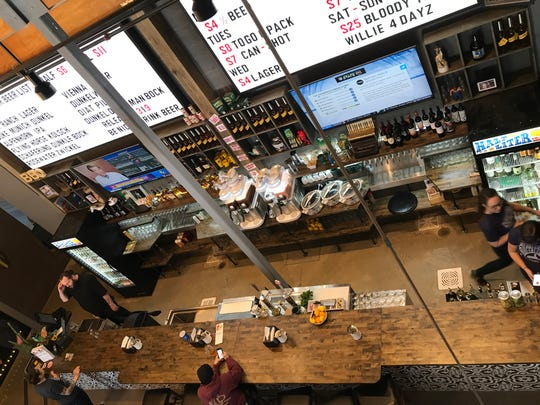 A loft dining area overlooks the bar at Half Liter BBQ, 5301 Winthrop Ave., Indianapolis. The restaurant opened March 4, 2019 south of Broad Ripple.
