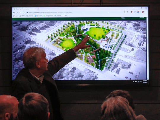 Westfield Mayor Andy Cook points out features of the proposed thirty five million dollar Grand Junction Plaza project during a information meeting held at Greeks Pizzeria in Westfield, on Monday, March 4, 2019. Concerned citizens and supporters of the project were in attendance to ask questions and discuss the proposed plan.