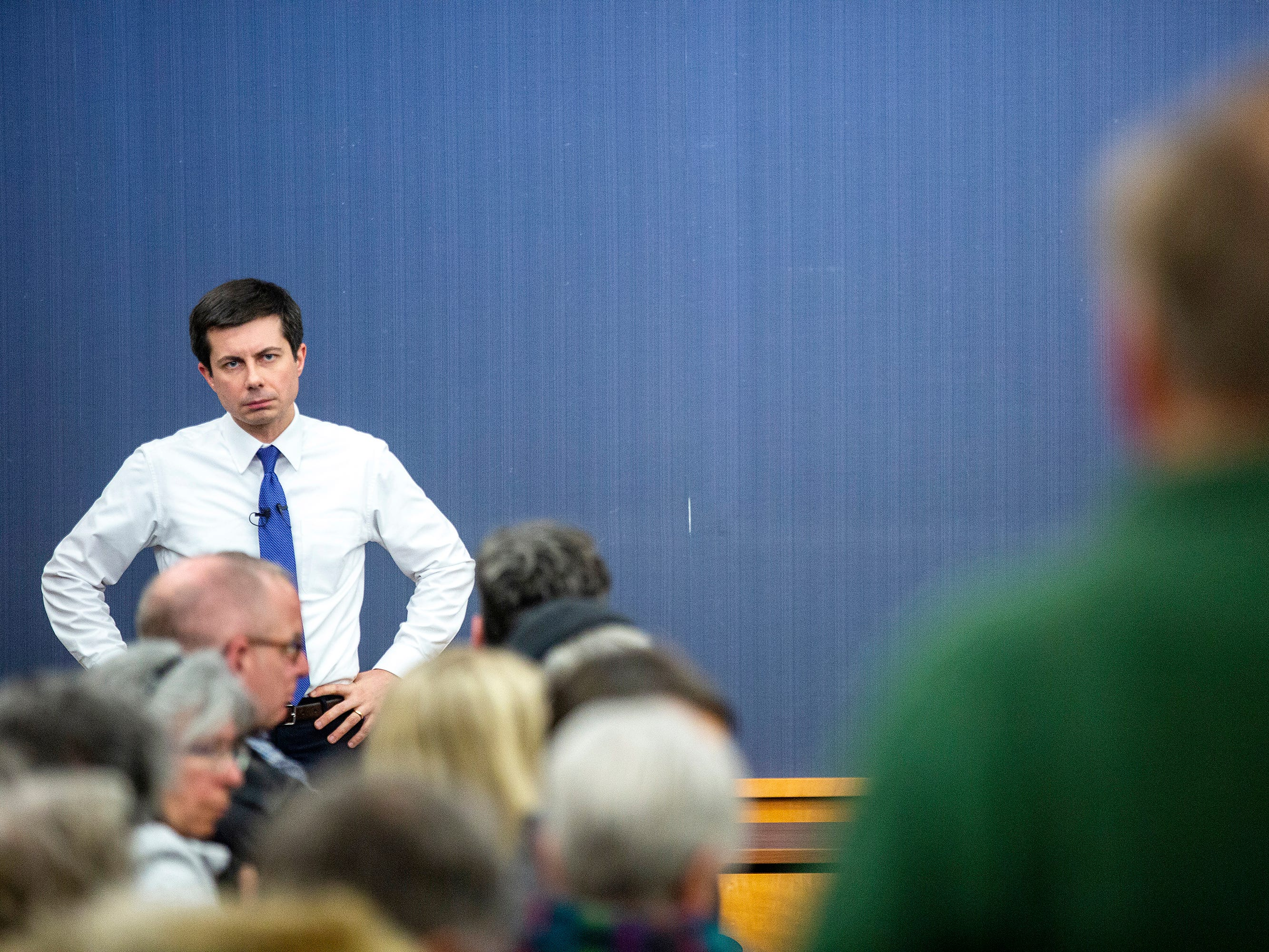 Pete Buttigieg, Mayor of South Bend, Indiana and 2020 Democratic presidential candidate, listens to a question during an event on Monday, March 4, 2019, at the Public Library in downtown Iowa City, Iowa.