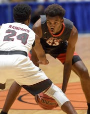 Florence Eagle Jaylen Forbes (23) looks to make a move against Gentry's Jesse Hull (24) in a semifinal game of the MHSAA C Spire State Basketball Championships at the Mississippi Coliseum in Jackson, Miss.