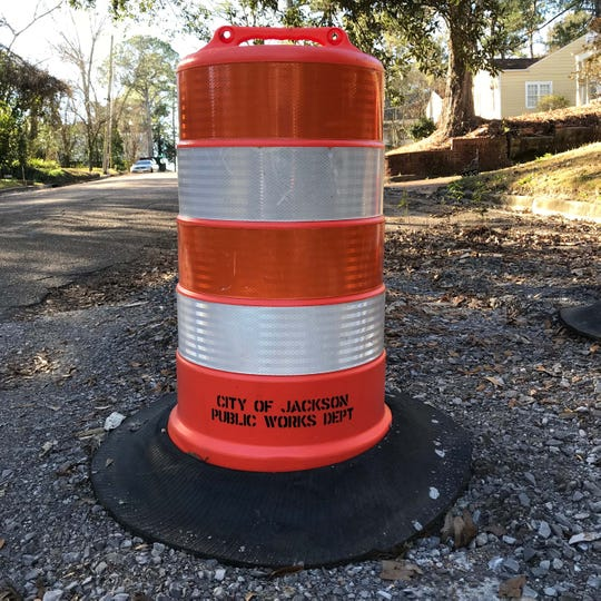 A city of Jackson Public Works Department barrel sits atop an unfinished road patching project in Belhaven in this Jan. 10, 2019, file photo.